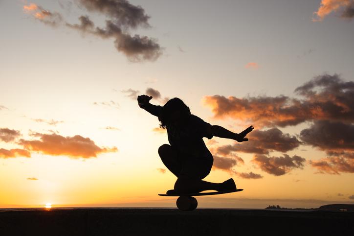 man balancing on a bongo board