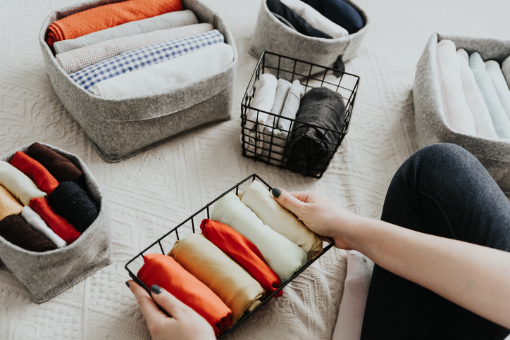 organizing clothes in baskets and bins