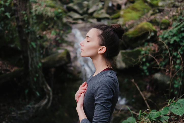 A woman practicing yoga - a form of self-care